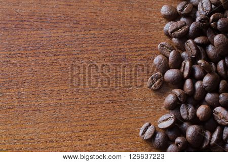 Coffee beans on wood background copy space