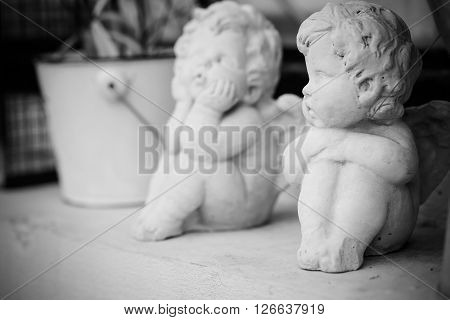 Cupid Doll stucco vintage black and white photo