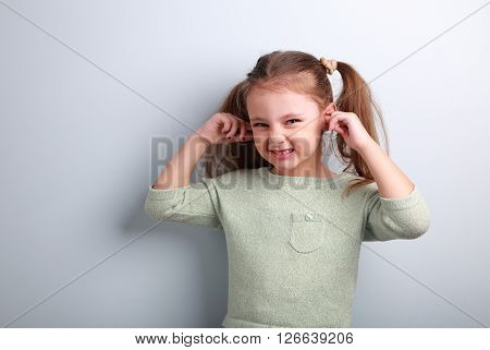 Cute Fun Kid Girl Coverd Ears The Fingers And Gesturing That Don Not Want To Listen