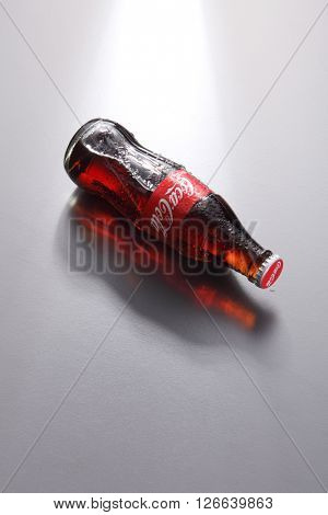 Kuala Lumpur,Malaysia -April 13 2016 high angle of coca cola bottle on the gray background