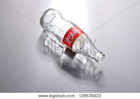 Kuala Lumpur,Malaysia -April 13 2016 high angle of empty coca cola bottle on the gray background