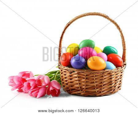 Multicoloured Easter eggs in basket isolated on white