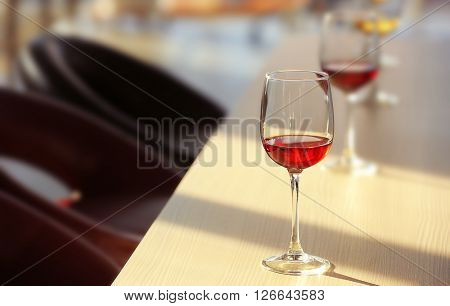 Glasses of red wine on the table, close up