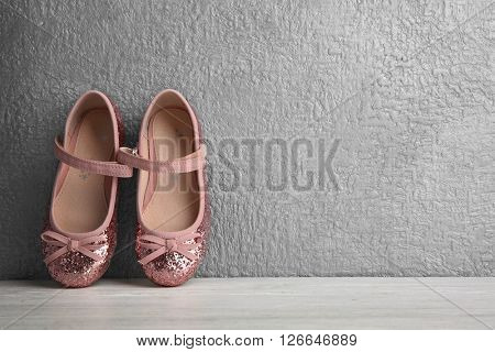 Pink Mary Jane flats for girls on grey textured background
