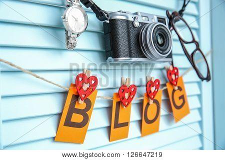 Word blog hanged on rope near wall