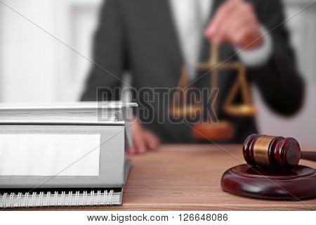 Young male judge working in his office