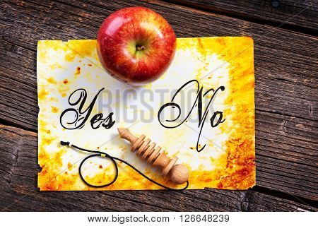 Pendulum, tool for dowsing, on yes and no choosing diagram with apple. Pointing Yes. Search for my other photo with pendulum pointing No.