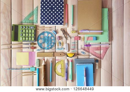 Flat lay of stationery on wooden background