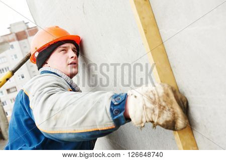 Construction worker. Builder concreter with level