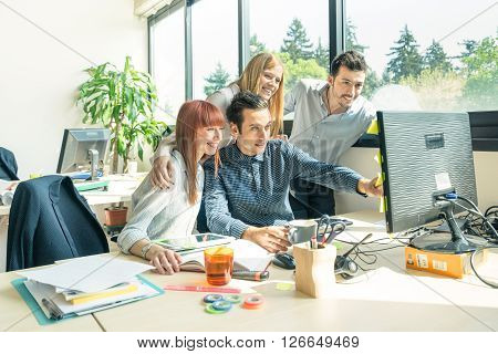 Group of young people employee workers with computer in urban alternative studio - Business concept of human resource and fun on working time - Start up entrepreneurs at office - Bright vintage filter