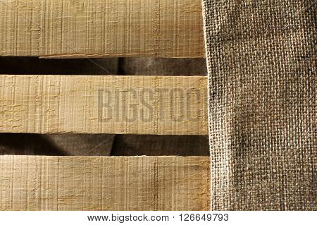 wooden paneling with sackcloth as a background