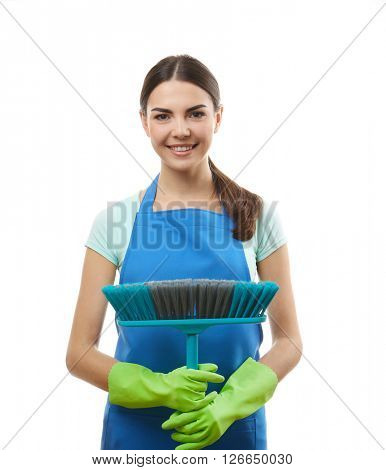 Young woman holding floor brush, isolated on white