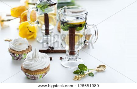 Tea With Lemon And Mint Cupcakes With Cream And Yellow Tulips