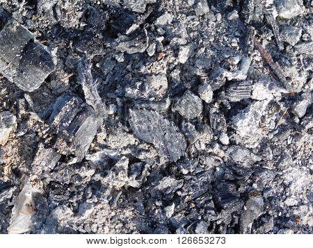 texture of outdoor charcoal in rural garden