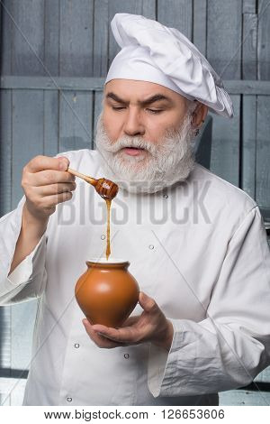 Cook Tasting Honey