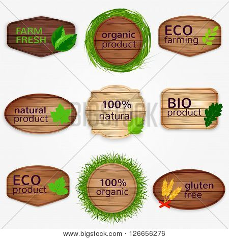 Wooden Eco labels , bages, stickers collection with green leaves and grass - Bio and natural product, natural, gluten free, organic product, farm fresh. Vector illustration.