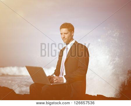 Businessman Staying Alone on the Beach Concept