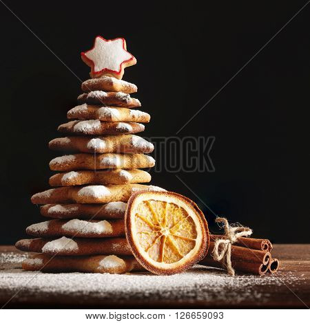 Christmas gingerbread cookies and spices on wooden background. Close-up