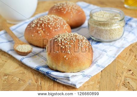 homemade buns with sesame seeds and milk for breakfast