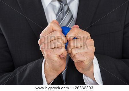 Businessman Pressing Stress Ball