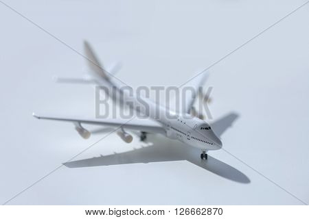 white airplane on black background