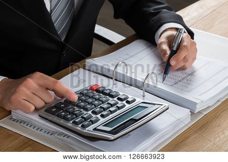 Male Accountant Calculating Tax