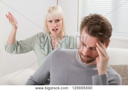 Woman Shouting To The Frustrated Man