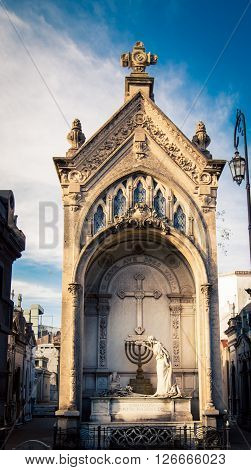 Angel lits a menorah in recoleta cemetery