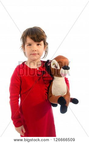 Sweet toddler play with deer plush isolated on white background