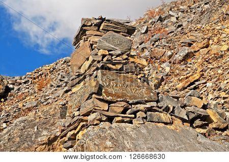 Zen rock arrangement that mimic the Stupa along hiking trail to the mountains of Annapurna, Nepal