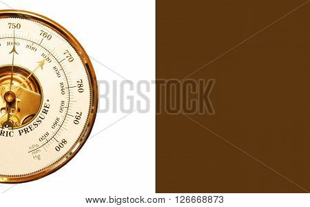Barometer is isolated on a white - brown background