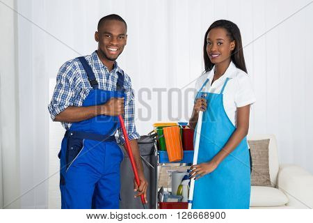 Portrait Of Male And Female Janitors