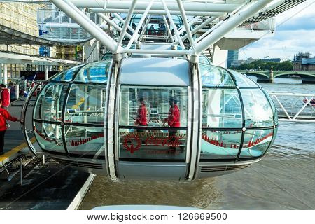 LONDON UK - JUNE 6 2015: Unidentified people inside London Eye cabin. London Eye is a giant Ferris wheel situated on the banks of the River Thames