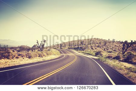 Vintage Toned Desert Road Seen Through Windshield Of A Moving Car