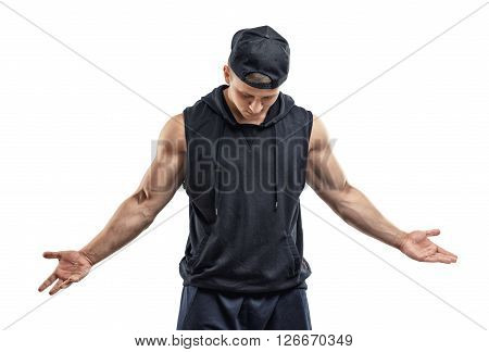 Cutout athletic man in cap wearing sleeveless shirt with hood stands with his head down gesticulating