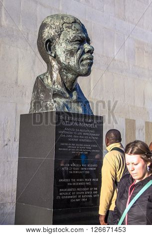 LONDON UK - JUNE 6 2015: Unidentified people near Nelson Mandela bust beside Royal Festival Hall at Southbank Centre