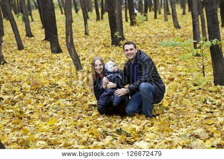 Family and his baby boy  in autumn park