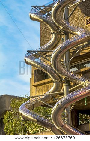 LONDON, UK - JUNE 6, 2015:Metal spiral pipes on the stone building wall for fire brigade downhill at Lambeth district
