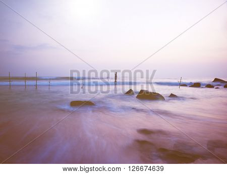 Dreamy Sea Coastline, Fishing Stilts with Young Boy Playing Concept