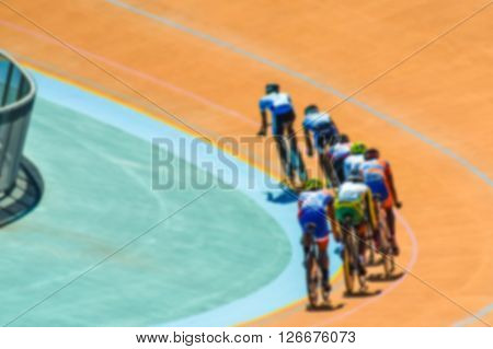 Bike race on velodrome track blurry for background