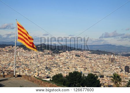 Barcelona, Catalonia, Spain - December 14, 2011: Catalan Flag Fluttering In The Wind In Montjuic Cas