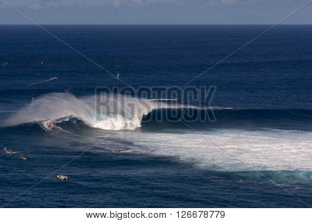Wind surfer on wave at Peahi or Jaws surf break, Maui, Hawaii, USA