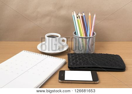 office desk : coffee with phonecalendarwalletcolor pencil on wood background