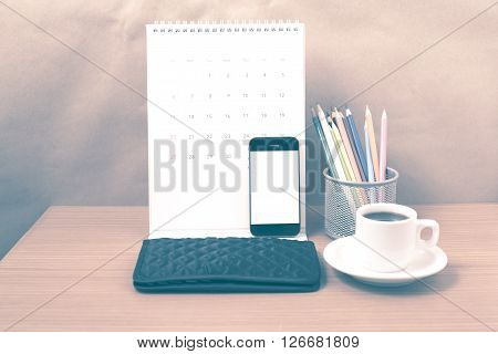 office desk : coffee with phonecalendarwalletcolor pencil on wood background vintage style