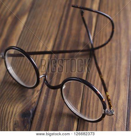 Antique XIX century glasses in selective focus.