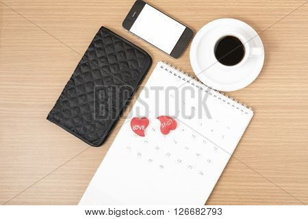 office desk,coffee with phone calendar wallet heart on wood background