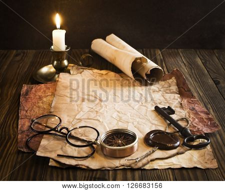 Vintage letter concept. candle, old paper, glasses on the wooden background