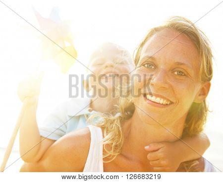 Mother Son Having Fun Beach Concept