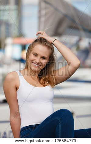 Portrait Of Beauty Woman On Marina