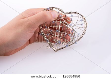 cage of a heart shape on a background